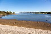Low water level Bristol Water, Chew Valley reservoir lake,  Herons Green Bay, Somerset, England, UK  submerged road exposed