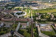 Nederland, Noord-Holland, Amsterdam, 14-06-2012; Amsterdam Zuidoost, overzicht oostelijk deel Bijlmermeer G-buurt met de nog resterende hoogbouw, de klassiek honingraatflats. In het midden de Bijlmerdreef met nieuwe flats, metrolijn en station Ganzenhoef. Diemen-Zuid en Diemen naar de horizon..Overview G-district, eastern part Amsterdam South-east (Blijmermeer) with remaining high-rise the classic honeycomb flats.    luchtfoto (toeslag), aerial photo (additional fee required).foto/photo Siebe Swart
