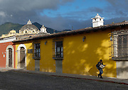 Local man reading a newspaper in Antigua, a UNESCO World Heritage Site in Guatemala
