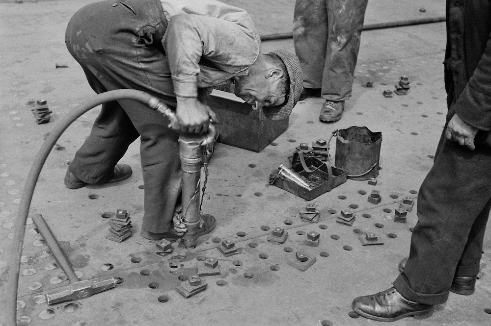 Worker Rivetting, Cunard Lines, England, 1934