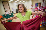 27 JUNE 2012 - GLENDALE, AZ:  CARMEN CORDOVA, 82 years old, dances during rehearsal for the Senior Fiesta Dancers at the Glendale Adult Center, in Glendale, AZ, a suburb of Phoenix. Dancing as a part of workout regimen is not unusual, but the Senior Fiesta Dancers use Mexican style folklorico dances for their workouts. The Senior Fiesta Dancers have been performing together for 15 years. They get together every week for rehearsals and perform at nursing homes and retirement centers in the Phoenix area once a month or so. Their energetic Mexican folklorico dances keep them limber and provide a cardio workout.   PHOTO BY JACK KURTZ