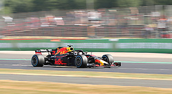 Red Bull Racing driver Daniel Ricciardo has sparks coming from his car, during practice ahead of the 2018 British Grand Prix at Silverstone Circuit, Towcester.