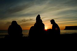© Licensed to London News Pictures. <br /> 11/08/2017. <br /> Saltburn by the Sea, UK.  <br /> <br /> A family sit on the beach having breakfast at sunrise in the North Yorkshire coastal town of Saltburn by the Sea.<br />   <br /> Photo credit: Ian Forsyth/LNP