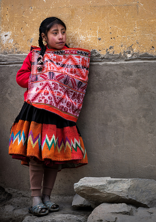 OLLANTAYTAMBO, PERU - CIRCA SEPTEMBER 2019:  Portrait of young girl from the andean community of Willoq close to Ollantaytambo in the Sacred Valley of Peru.