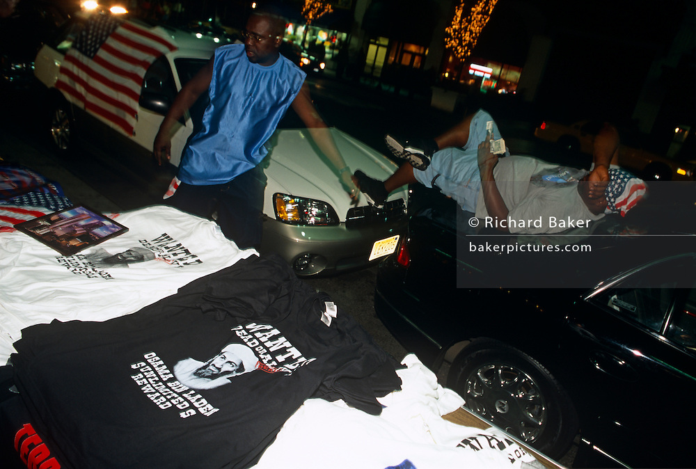 Osama bin Laden t-shirts are on sale at night in the streets of Manhattan, only days after the attacks on New York's twin towers