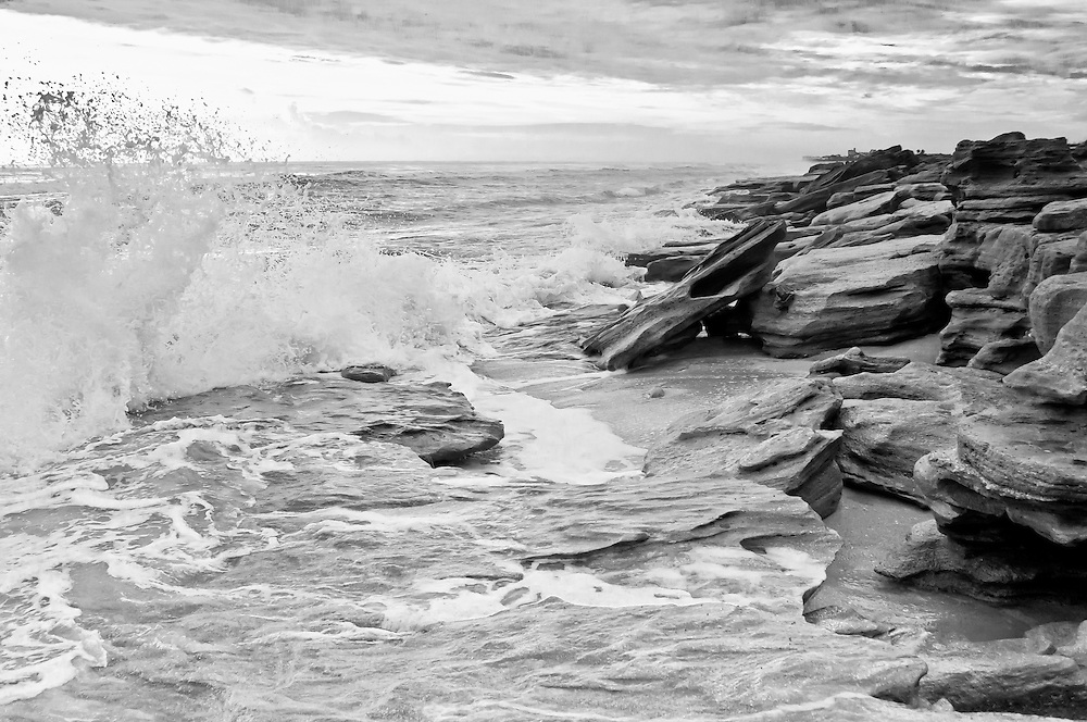 A rare and strange formation of coquina rocks on Florida's Atlantic coast. The sky was overcast that morning and was perfect for shooting crashing waves!