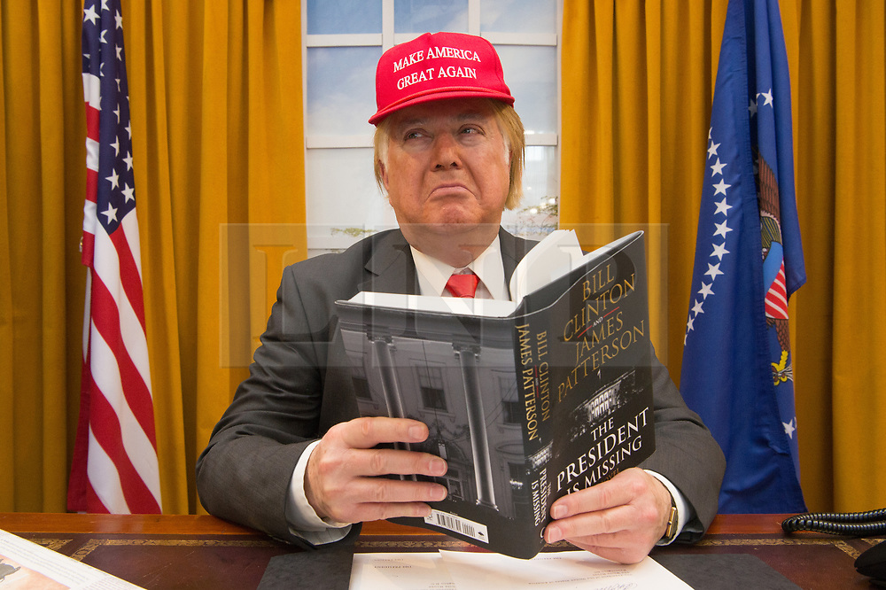 © Licensed to London News Pictures. 10/04/2018. London, UK. A DONALD TRUMP look-a-like promotes the the novel 'The President Is Missing'  by Bill Clinton and James Patterson. Photo credit: Ray Tang/LNP
