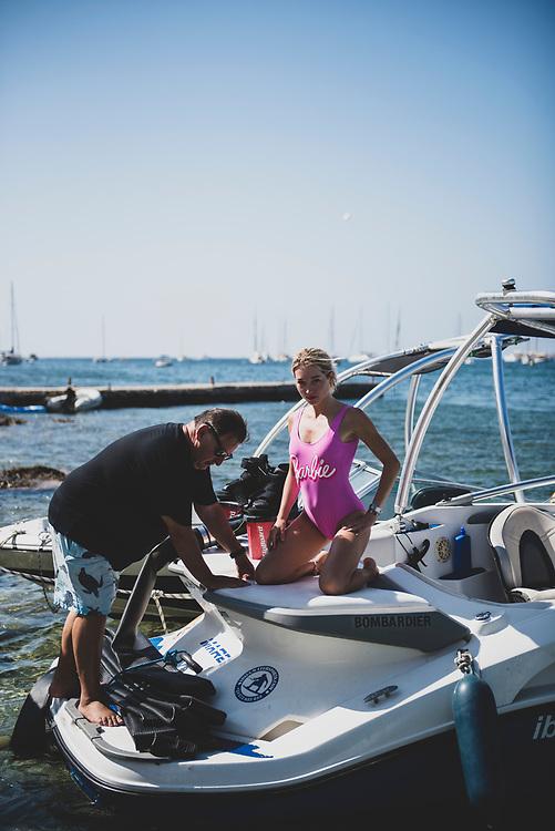Sant Antoni de Portmany, Ibiza, Spain - July 29, 2018: Two people board a chartered boat in Sant Antoni (San Antonio), Ibiza.