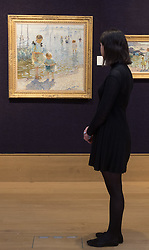 Bonhams, London, February 22nd 2017. Bonhams in London hold a press preview ahead of their 19th century paintings sale, featuring numerous valuable works including:<br /> • 'Children by the shore' by Dorothea Sharp, valued at £60,000-80,000<br /> • Barcas y pescaadores, Playa de Valencia by Joaquin Sorolla £60,000-80,000<br /> • When the Boats Come In by Walter Osborne valued at £100,000-150,000<br /> • A Solicitation by Lawrence Alma-Tadema which is expected to fetch between £30,000-50,000<br /> PICTURED: A woman admires Children by the shore' by Dorothea Sharp