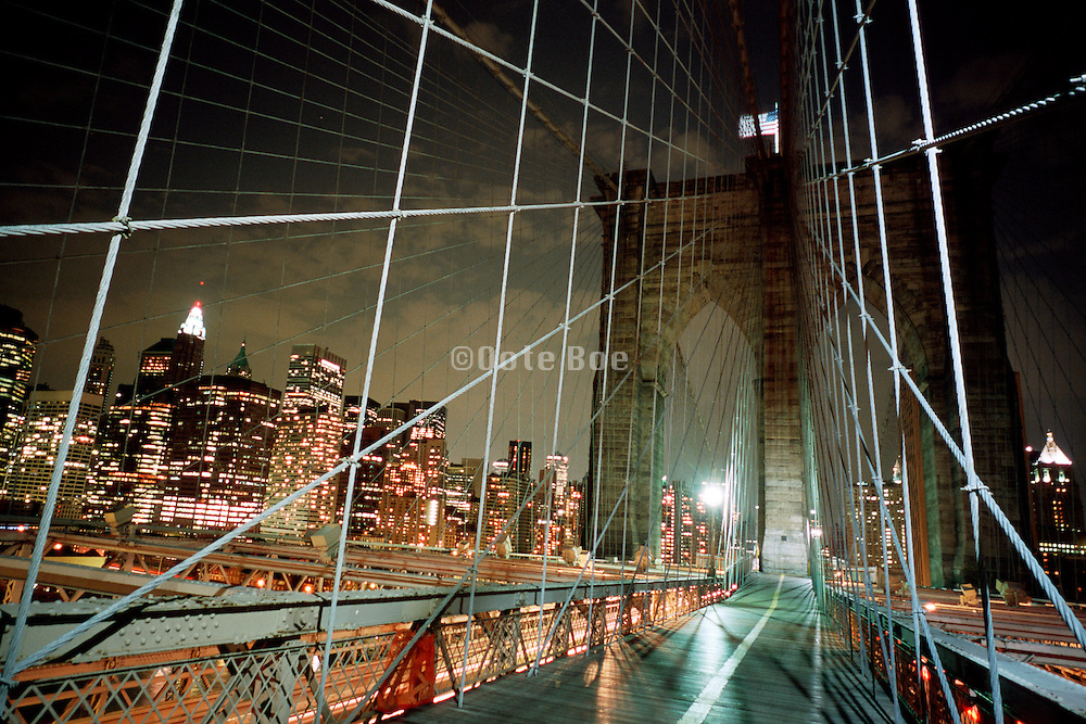 Brooklyn Bridge at night with Manhattan in the background