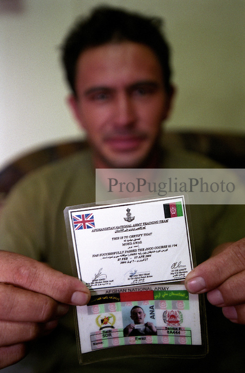 "AFGHANISTAN NATIONAL ARMY TRAINING TEAM ..""THIS IS TO CERTIFY THAT MOHD AWAZ  HAS SUCCESSFULLY PASSED THE JNCO COURSE 01/04 ..27 FEB - 07 APR 2004"""