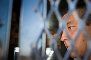 05 OCTOBER 2005 - DOUGLAS, AZ:  JUAN PABLO PEREZ FERREIRA, sits in a US Border Patrol vehicle after he was apprehended in the desert east of Douglas, AZ. Ferreira said he was originally from Mexico City and was trying to get to Phoenix, AZ, where he had a job working as a house painter waiting for him. Apprehensions of illegal immigrants in the Douglas area are down significantly in the last 18 months. In 2003, the Border Patrol apprehended an average of 1,500 people a day in and around Douglas. In September and October 2005 they are apprehending only about 150 - 200 people a day.  PHOTO BY JACK KURTZ