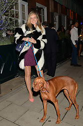 VICTORIA CHAPMAN and her dog Ruby at a party to celebrate 35 years of Harry's Bar, 26 South Audley Street, London on 19th September 2014.