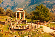The Tholos at the sanctuary of Athena Pronaia,  a circular building with Doric columns that was constructed between 380 and 360 BC. Delphi, archaeological site, Greece, .<br /> <br /> If you prefer to buy from our ALAMY PHOTO LIBRARY  Collection visit : https://www.alamy.com/portfolio/paul-williams-funkystock/delphi-site-greece.html  to refine search type subject etc into the LOWER SEARCH WITHIN GALLERY.<br /> <br /> Visit our ANCIENT GREEKS PHOTO COLLECTIONS for more photos to download or buy as wall art prints https://funkystock.photoshelter.com/gallery-collection/Ancient-Greeks-Art-Artefacts-Antiquities-Historic-Sites/C00004CnMmq_Xllw