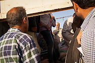 A truck carrying Syrian Kurdish refugees from Kobane/Ayn al-Arab arrives outside a refugee camp set up for the estimated 130,000 people flooding into Turkey to escape an offensive by Islamic State militants.