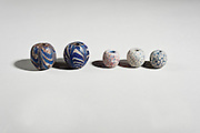 Glass Beads Islamic Period 15-18 century on the left and first century Roman period on the right
