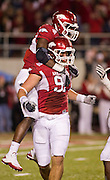 Nov 5, 2011; Fayetteville, AR, USA;  Arkansas Razorback defensive end Jake Bequette (91) and linebacker Jerry Franklin (34) react to a sac made by Bequette during the first half of a game against the South Carolina Gamecocks at Donald W. Reynolds Stadium.  Mandatory Credit: Beth Hall-US PRESSWIRE