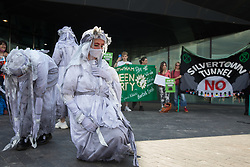 Extinction Rebellion banshees perform in front of environmental activists and local residents protesting against the construction of the Silvertown Tunnel on 5th June 2021 in London, United Kingdom. Campaigners opposed to the controversial new £2bn road link across the River Thames from the Tidal Basin Roundabout in Silvertown to Greenwich Peninsula argue that it is incompatible with the UK's climate change commitments because it will attract more traffic and so also increased congestion and air pollution to London's most polluted borough.