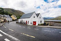 White shop and road through Leenaun, County Galway, Ireland