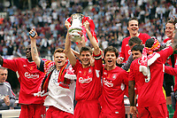 Photo: Chris Ratcliffe.<br /> Liverpool v West Ham United. The FA Cup Final. 13/05/2006.<br /> Steven Gerrard of Liverpool celebrates by lifting the trophy.