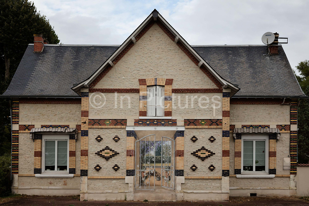 Decorated house with trompe doeil in doorway 17th September 2016 in Romorantin-Lanthenay, France. The tiled building is a gatehouse for the large estate in the Loire valley.