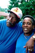 Spouses age 60 watching Rondo Days parade.  St Paul  Minnesota USA