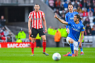 Charlie Wyke of Sunderland (9) and Christian Burgess of Portsmouth (6) reacts during the EFL Sky Bet League 1 first leg Play Off match between Sunderland and Portsmouth at the Stadium Of Light, Sunderland, England on 11 May 2019.