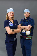 Pair of doctors wearing PPE in a studio
