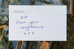© Licensed to London News Pictures . 10/03/2014 . Farnworth , UK . Tributes left at the scene . Police and forensic scenes of crime examiners at a house on Kildare Street , Farnworth , where the body of 40 year old Marc Jepson was discovered on 5th March , as Greater Manchester Police announce that they have arrested two people as part of their murder enquiry . A 27 year old man and a 63 year old woman are in police custody for questioning . Photo credit : Joel Goodman/LNP