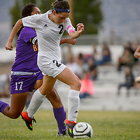 Grants Pirate Phoebe Rychener (2) breaks away from Kirtland Central Bronco Nikkinna Begay (17) for a scoring shot Thursday at Grants High School.