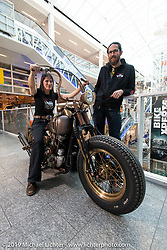 Mac Fröhlich' with his wife Sandra Fröhlich of McSands Motor Shop in Balterswil (Switzerland) with her Galvano 1948 Harley-Davidson Knucklehead at the Swiss-Moto Customizing and Tuning Show. Zurich, Switzerland. Sandra rebuilds all of the engines for the shop including this Knucklehead. Sunday, February 24, 2019. Photography ©2019 Michael Lichter.