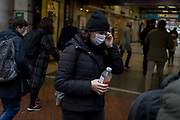 As the Coronovirus pandemic takes hold across the UK, with health authorities reporting cases rising from 25 to 87 in a single day, and resulting in the UKs chief medical officer Prof Chris Whitty announcing that an epidemic in the UK was highly likely, a lady wearing a surgical mask passes through Embankment Underground station, on 4th March 2020, in London, England.