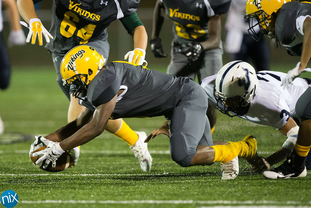 Makhi Jones (9) of the Central Cabarrus Vikings recovers a fumble against the Hickory Ridge Ragin' Bulls at Central Cabarrus High School on September 25, 2015 in Concord, North Carolina.  The Ragin' Bulls defeated the Vikings 41-12.  (Brian Westerholt/Special to the Tribune)