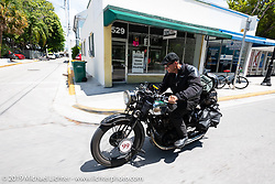 Todd Cameron riding his 1930 BSA Sloper in memory of his Grandfather, JD John Cameron, a motorcycle racer, restorer and founding member of the Boozefighters MC. Here he is riding through the streets of Key West as he is about to take his first place win in the Cross Country Chase motorcycle endurance run from Sault Sainte Marie, MI to Key West, FL. (for vintage bikes from 1930-1948). Riding through town just before at the end of the 110 mile Stage-10 ride from Miami to Key West, FL USA. Sunday, September 15, 2019. Photography ©2019 Michael Lichter.