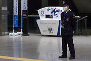 A security guard inside the Tokyo metropolitan Government Tower  with a countdown clock behind showing 99 days to the start of delayed 2020 Tokyo Olympics. Shinjuku, Tokyo, Japan. Thursday April 15th 2021 With Coronavirus cases rising and no large rollout of a vaccine scheduled the future of the troubled Tokyo Olympics remains uncertain.