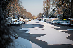 © Licensed to London News Pictures. 28/02/2018. London, UK. Picturesque scenes at sunrise in Little Venice, West London following heavy snowfall last night. Large parts of the UK are experiencing disruption as 'Storm Emma' hits, following Russian a cold front earlier in the week named 'The Beast From The East'. Photo credit: Ben Cawthra/LNP