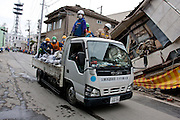 Peace Boat volunteers take part in clean up operations in Ishinomaki that was bad affected by the earthquake and tsunami that struck on March 11th.  Ishinomaki, Miyagi, Japan. Friday May 6th 2011
