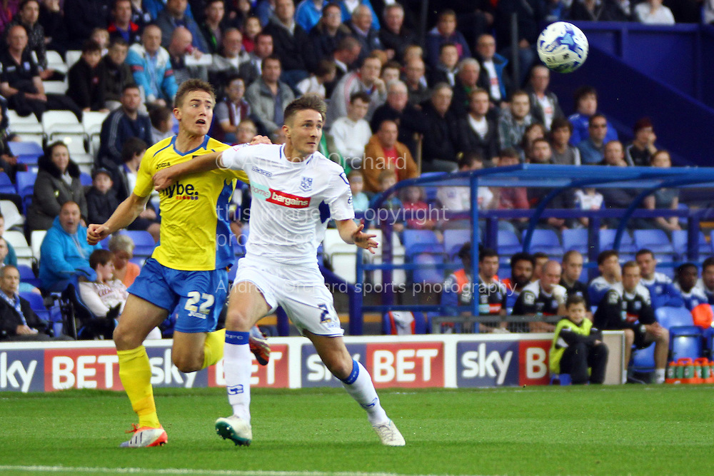 Exeter City's David Wheeler and Tranmere Rovers' Ben Davies battle for the ball. Skybet football league two match, Tranmere Rovers v Exeter city at Prenton Park in Birkenhead, the Wirral on Saturday 20th Sept 2014.<br /> pic by Chris Stading, Andrew Orchard sports photography.