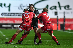 Ospreys' Jeff Hassler is tackled by Scarlets' Hadleigh Parkes and Johnny McNicholl - Mandatory by-line: Craig Thomas/Replay images - 26/12/2017 - RUGBY - Parc y Scarlets - Llanelli, Wales - Scarlets v Ospreys - Guinness Pro 14