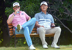 July 13, 2018 - Silvis, Illinois, U.S. - SILVIS, IL - JULY 13:  Trey Mullinex and Danny Lee take a break before teeing off on the #2 hole during the second round of the John Deere Classic on July 13, 2018, at TPC Deere Run, Silvis, IL.  (Photo by Keith Gillett/Icon Sportswire) (Credit Image: © Keith Gillett/Icon SMI via ZUMA Press)