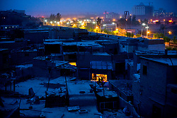 View of old city in Kashgar, which is being demolished, foreground, and new development, background.