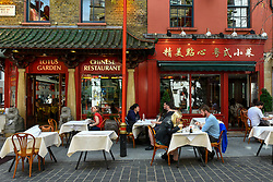 "© Licensed to London News Pictures. 17/08/2020. LONDON, UK. Customers eat outdoors at a restaurant in Chinatown which is participating in the UK government's ""Eat Out to Help Out Scheme"".  Diners receive a 50% discount (up to £10) on food or non-alcoholic drinks to eat or drink in, every Monday, Tuesday and Wednesday between 3 and 31 August.  The scheme is aimed at boosting the revenues of the hospitality industry which has been hard hit during the ongoing coronavirus pandemic..  Photo credit: Stephen Chung/LNP"