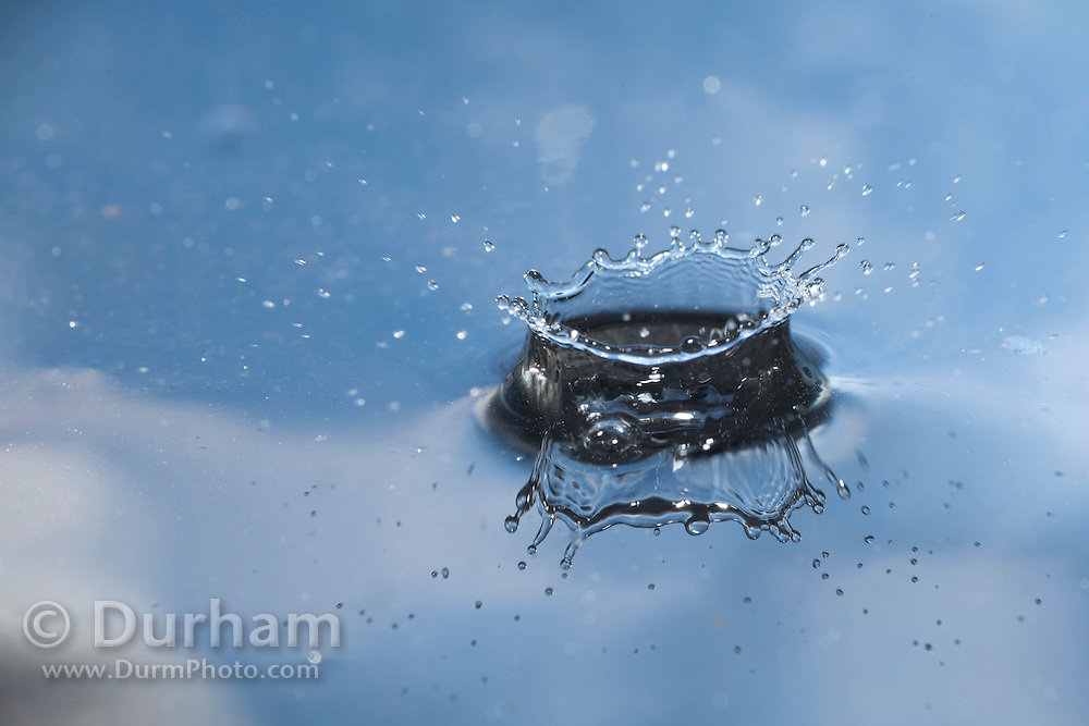 A splash of water with sky reflection.