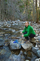 Filtering water from Big Sur River, Sykes Hot Springs, Big Sur, California.