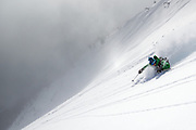 Professional athlete, photoghrapher and filmmaker Jimmy Chin descends perfect powder during a day of backcountry skiing with a film crew on Teton Pass near Jackson, Wyoming.  Photo by David Stubbs