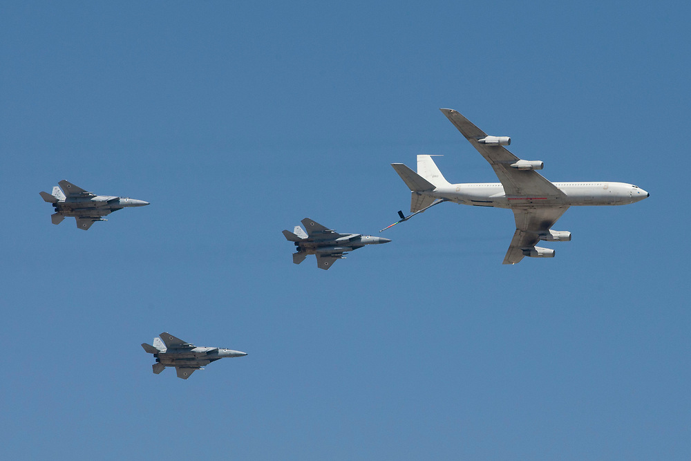 A KC-135 Stratotanker Boeing 707 plane and three Israeli Air Force F-15 fighter jets fly in formation over Jerusalem's Old City, during Israel's 64th Independence Day anniversary celebrations, on April 26, 2012.