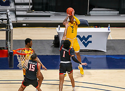 Jan 25, 2021; Morgantown, West Virginia, USA; West Virginia Mountaineers forward Jalen Bridges (2) shoots a three pointer over Texas Tech Red Raiders guard Terrence Shannon Jr. (1) during the first half at WVU Coliseum. Mandatory Credit: Ben Queen-USA TODAY Sports