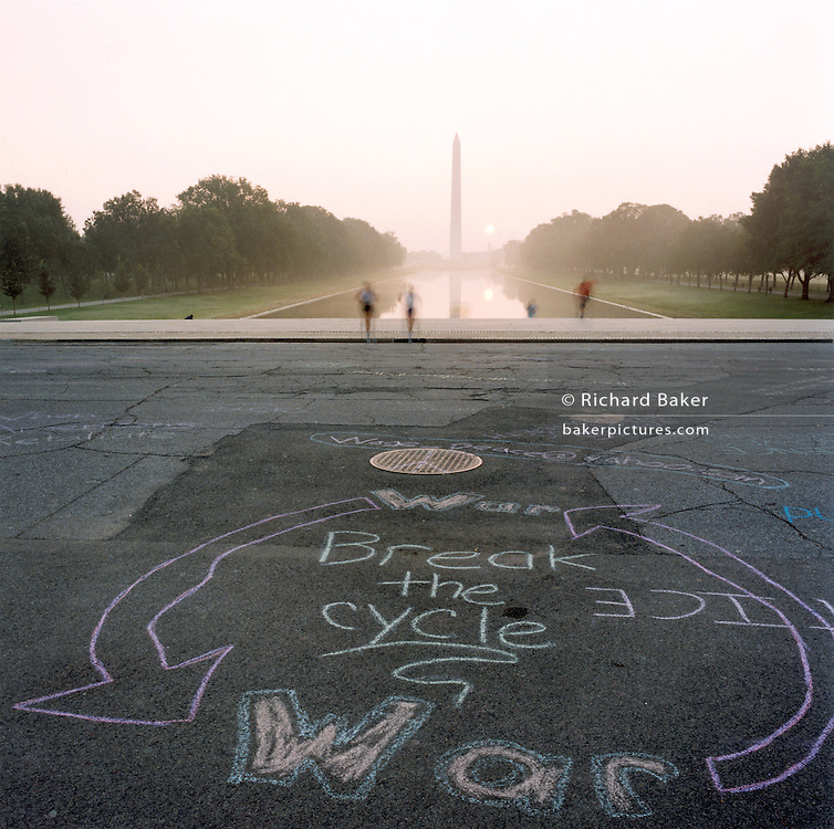 """Anti-war graffiti at the Lincoln memorial, Washington DC..Patriotic Americana - After 9/11. Chalked anti-war graffiti on the pavement near the Lincoln Memorial. In the week after the September 11th attacks, America sought to express their anger and patriotic unity. Rarely-seen anti-war graffiti was chalked overnight around the Lincoln Memorial in Washington DC, angering Vietnam veterans and visitors paying respects to the nation?s war monuments. """"Look at this, Jane Fonda's grand kids - damned peace nicks!"""" - Overheard from a passer-by."""