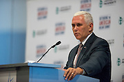 Indiana Gov. Mike Pence speaks during the Defending the American Dream Summit hosted by Americans For Prosperity at the Omni Hotel in Dallas, Texas on August 29, 2014. (Cooper Neill for The New York Times)