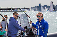 Hugo Boss skipper Alex Thomson (left) aboard his rib with friends and family at the start of the 90th anniversary Rolex Fastnet Race on the Solent. A record fleet of 370 yachts will compete to win the Fastnet Challenge Cup.<br /> The 600 nautical mile race starts in Cowes, Isle of Wight, heading to the Fastnet Rock off the south west coast of Ireland and finishes in Plymouth.<br /> It is the world's biggest offshore race with 75% amateur sailors and professional yachtsmen competing against each other. <br /> Picture date Sunday 16th August, 2015.<br /> Picture by Christopher Ison. Contact +447544 044177 chris@christopherison.com